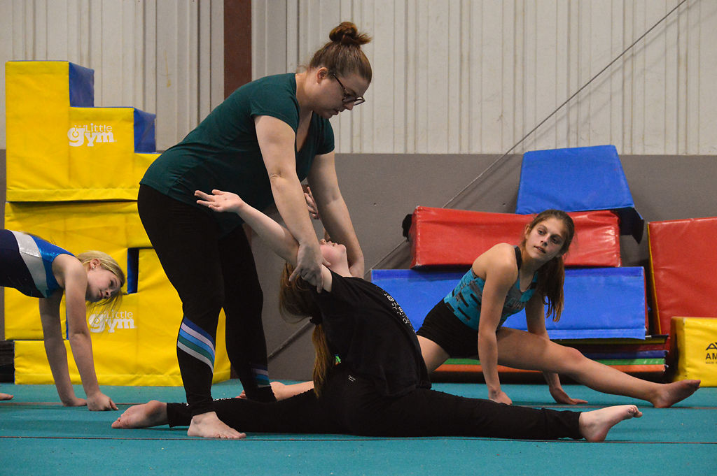 Nicole Clemens helps a student with her form