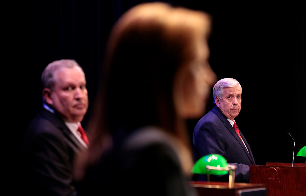 Gov. Mike Parson listens to State Auditor Nicole Galloway answering a question with Libertarian candidate Rik Combs