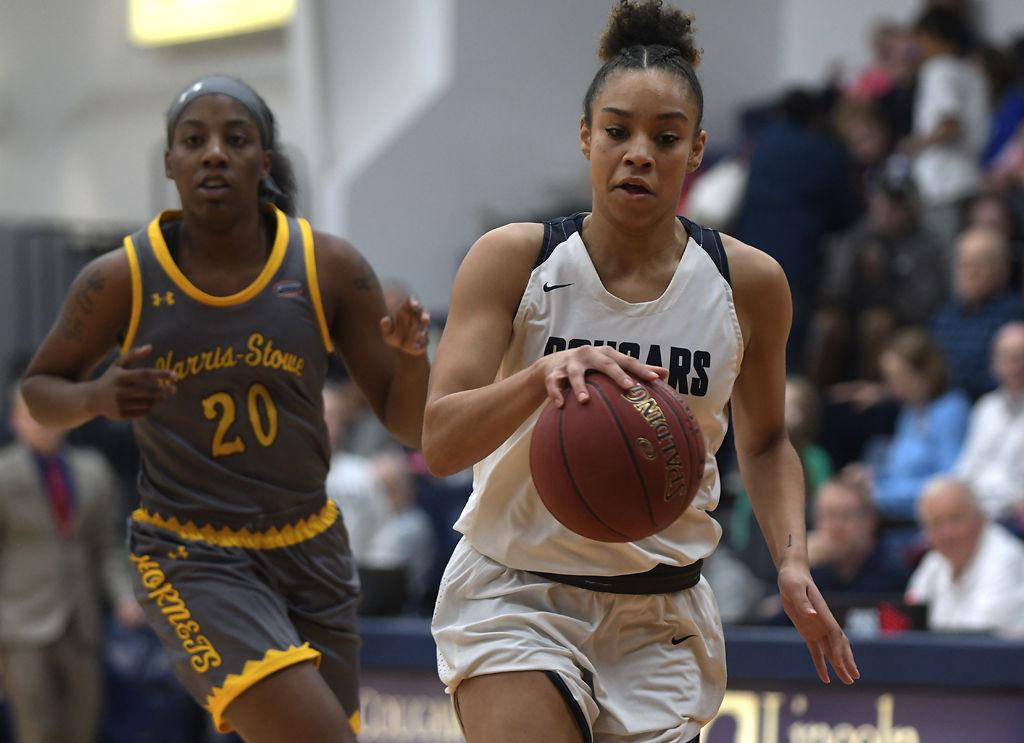 Geena Stephens drives the ball down