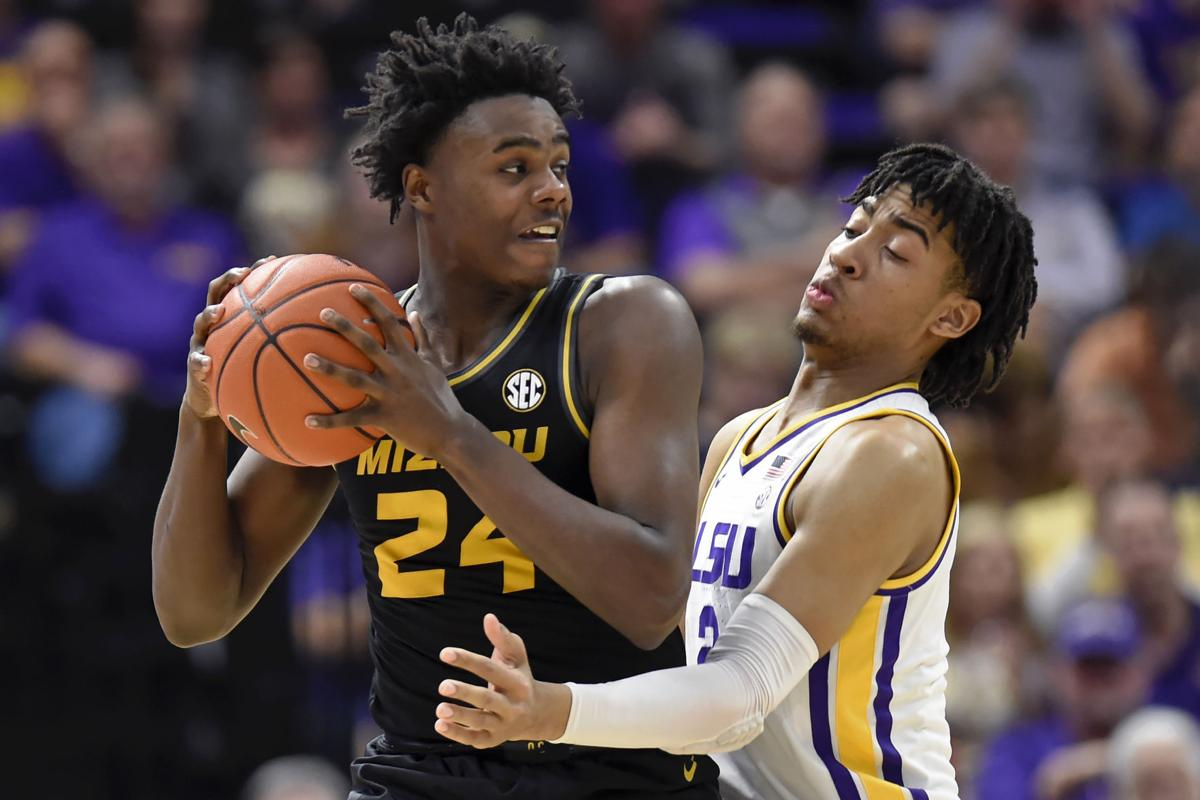 Kobe Brown is guarded by Trendon Watford
