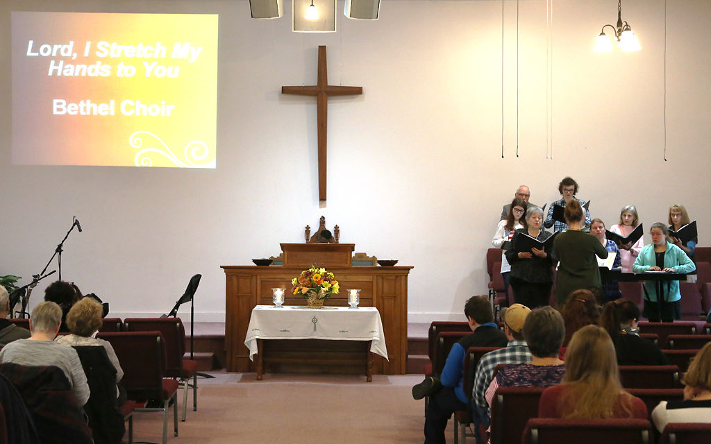 The Bethel Church Choir performs during worship
