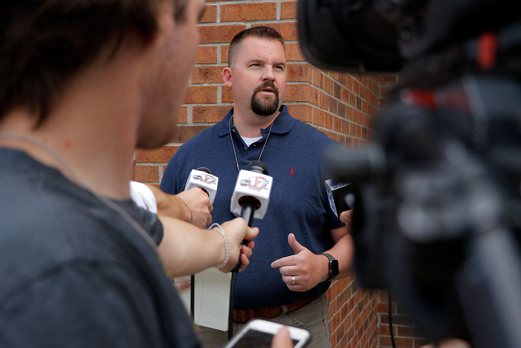 Jeremiah Hunter answers questions at a small press conference