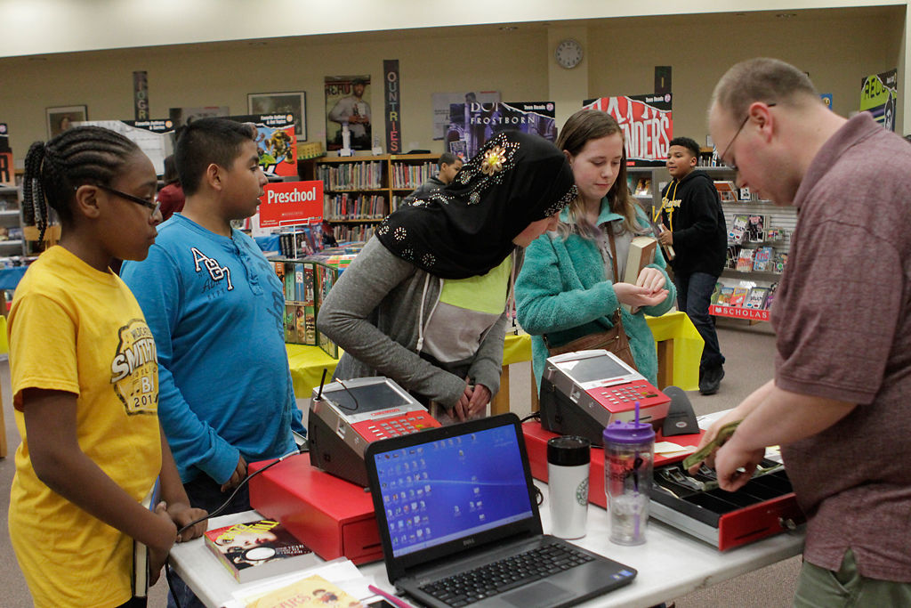 Kids from Smithton Middle School get ready to purchase books