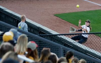 116f4a8018d Missouri left fielder Regan Nash sprints to catch a ball