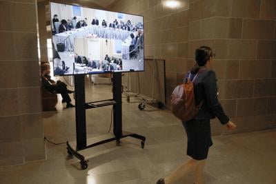 A screen streaming the Conference Committee on Budget stands