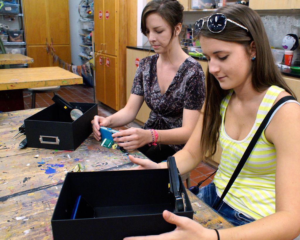 McKayla Helm and Kristyn Long make projectors