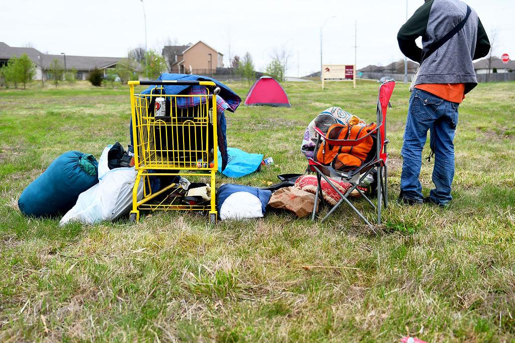 A homeless man packs up his belongings