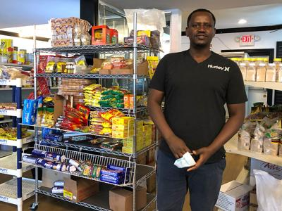 Mahinga Tubirori owns the African Market