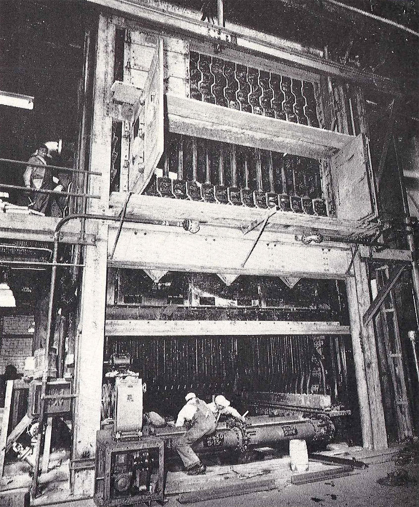 Workers install a coal-fired boiler