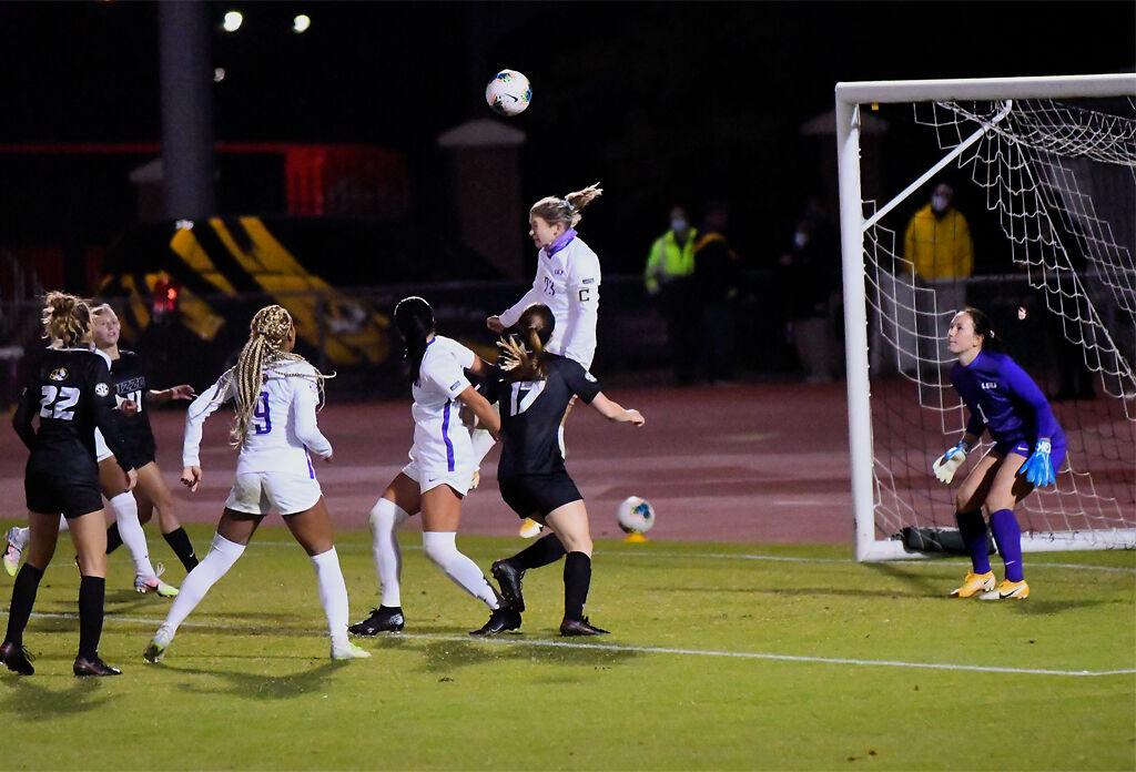 LSU midfielder Maddie Moreau attempts to block the ball