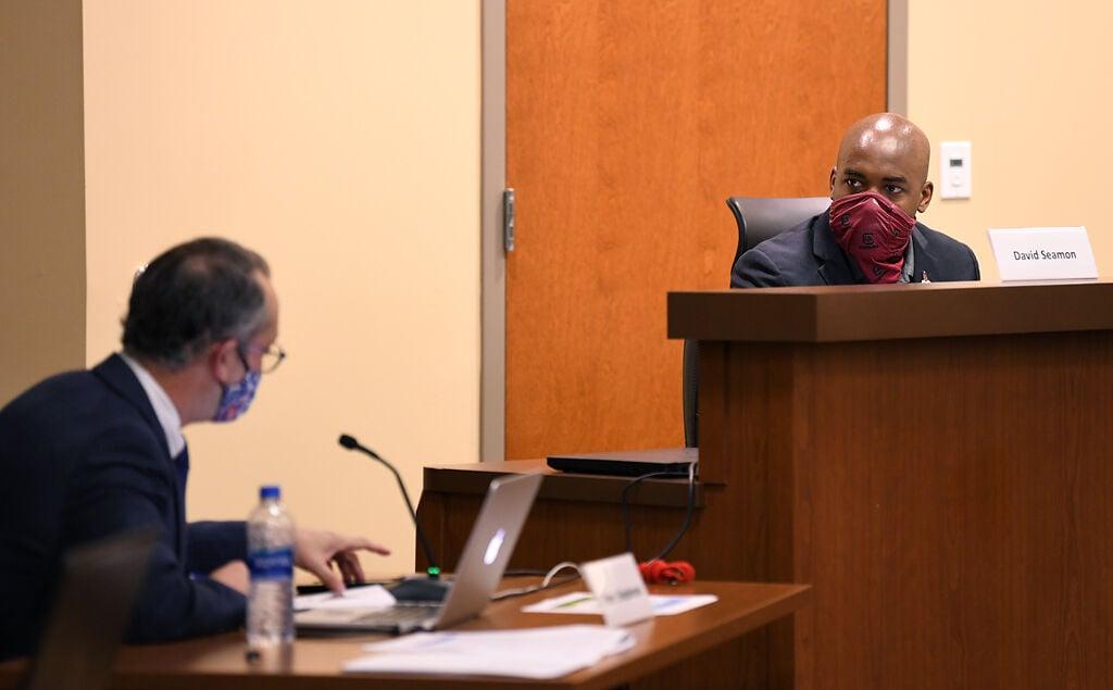 School Board member David Seamon listens as Columbia Public Schools Superintendent answers his questions