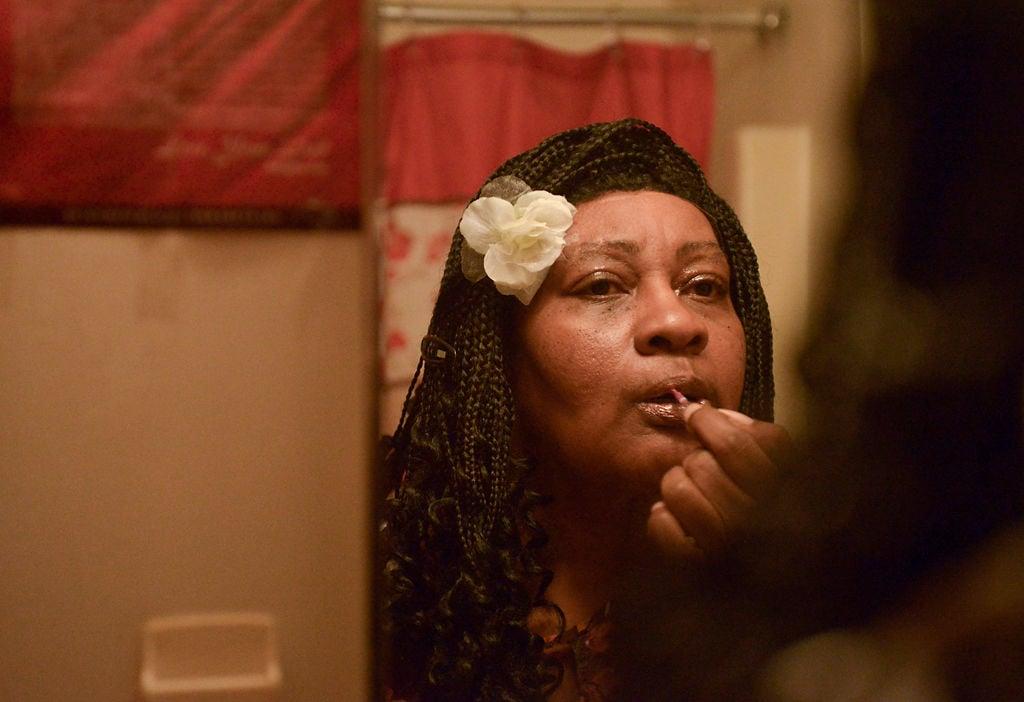Donna Fullington applies lipstick