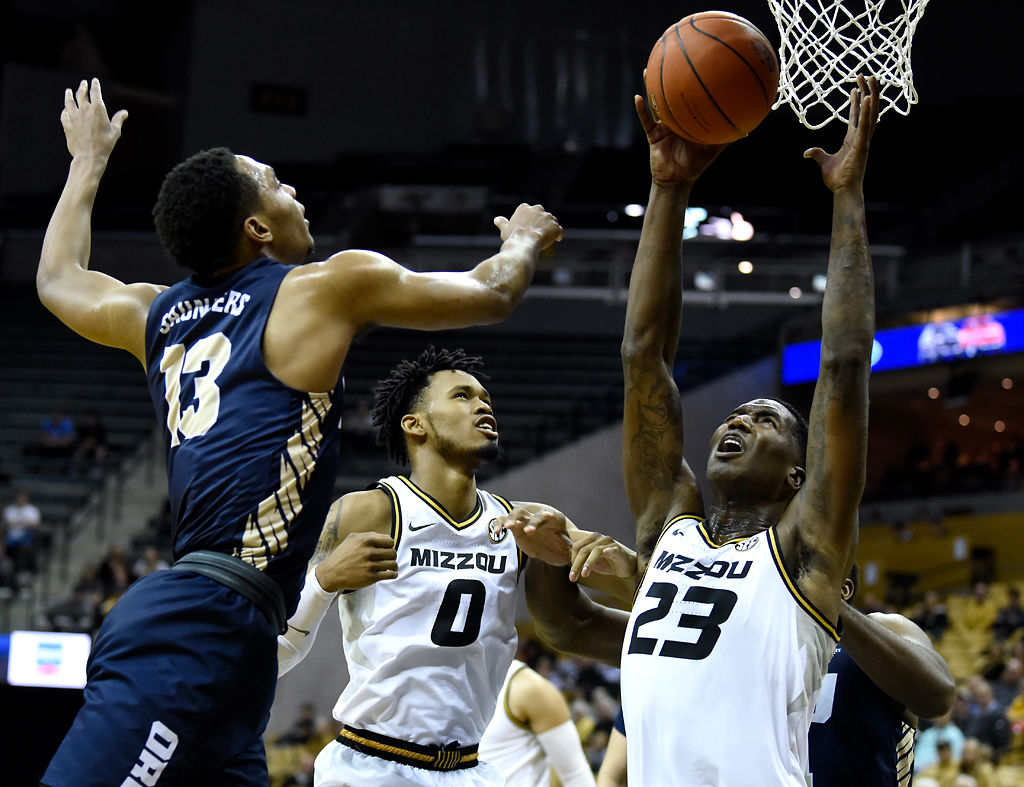 Jeremiah Tilmon, right, reaches for a rebound over Oral Roberts' Aidan Saunders (copy)