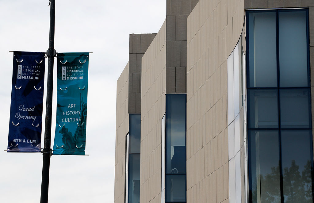 A banner promoting the State Historical Society of Missouri's grand opening stands along Elm St.