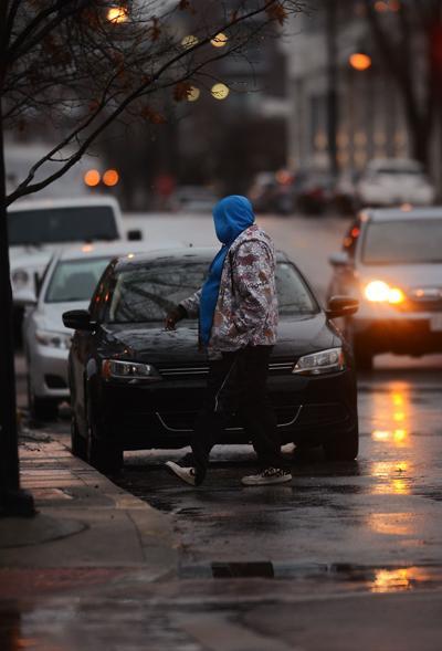 A pedestrian walks through downtown Columbia