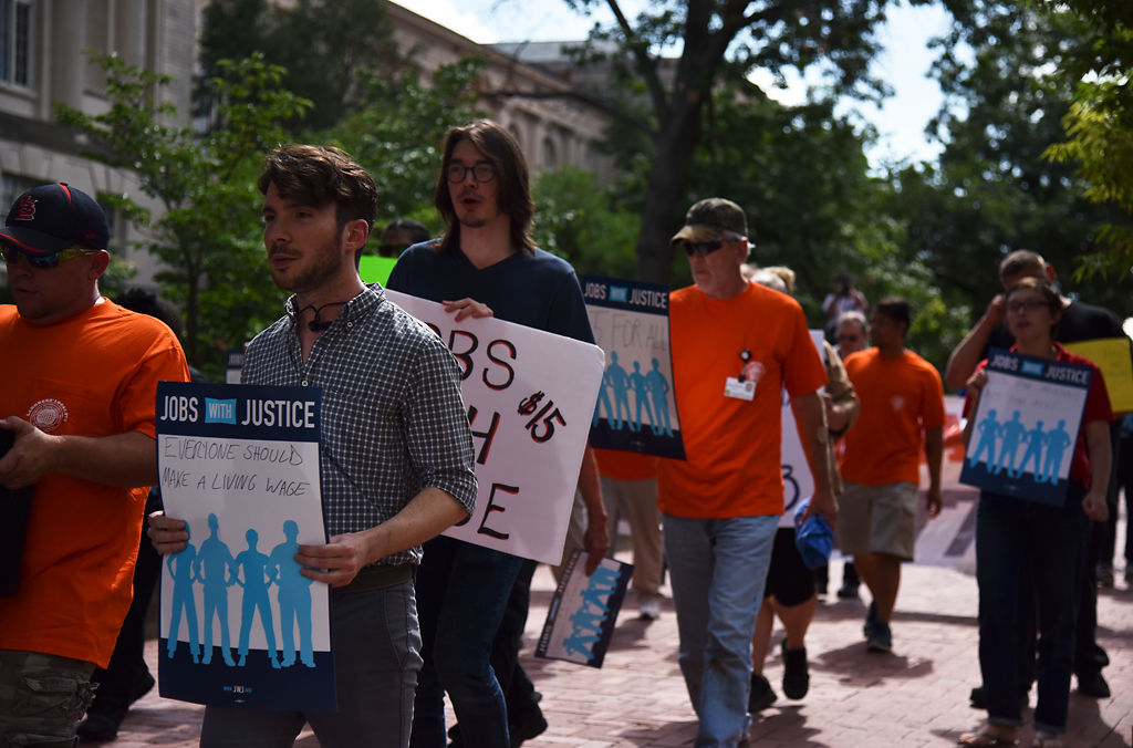 Rally participants walked and chanted from Traditions Plaza to Memorial Union