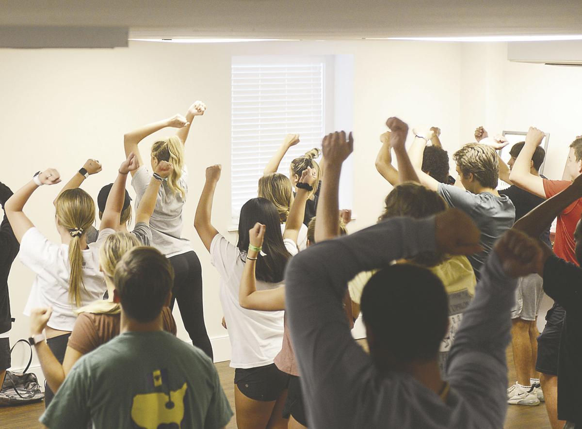 Dance group members of Gamma Phi Beta, Delta Upsilon and Alpha Kappa Lambda follow the steps
