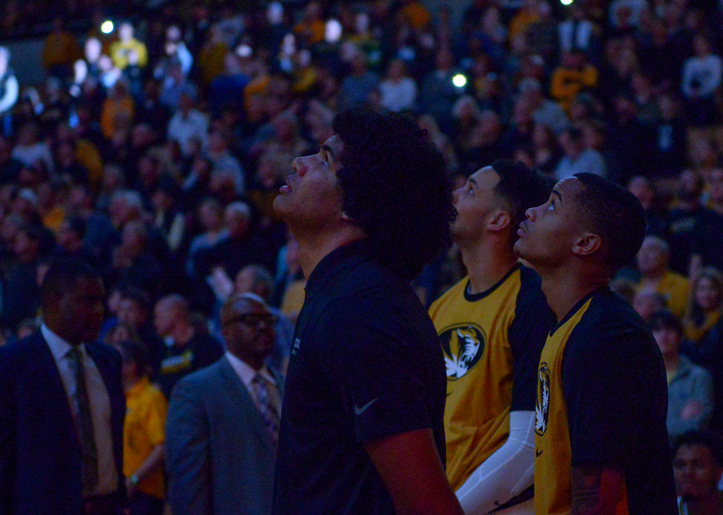 Missouri's Dru Smith watches the screen above the court