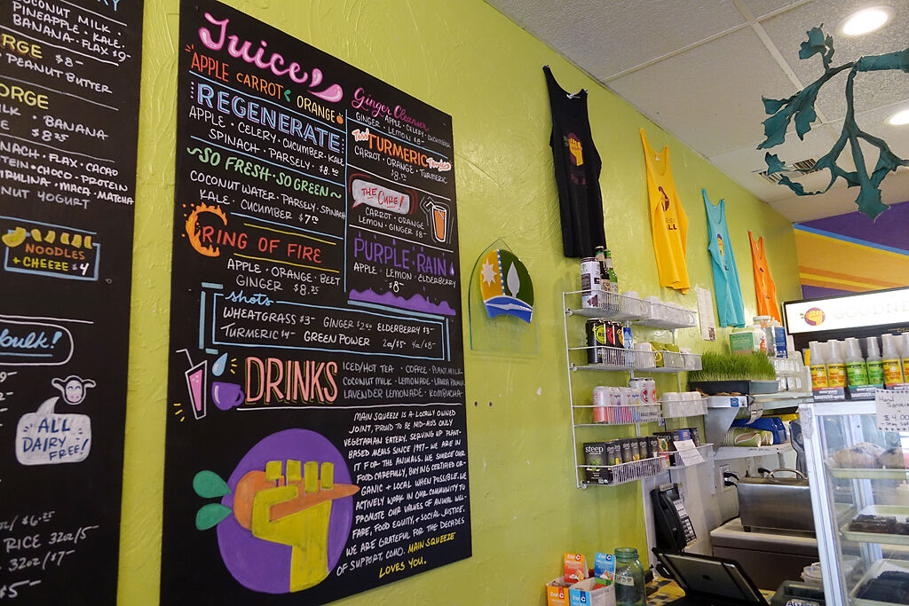 A colorful menu hangs on the walls of Main Squeeze