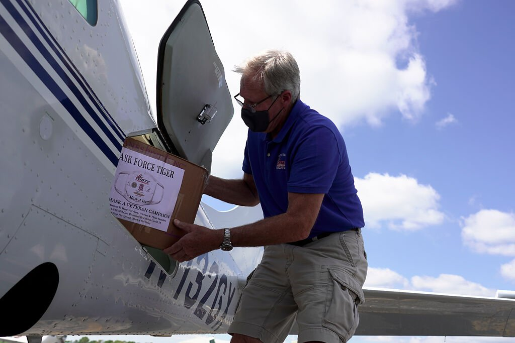 """Steve Wendling loads boxes of masks into his plane Sunday in Fulton for the """"Mask a Vet"""" campaign"""