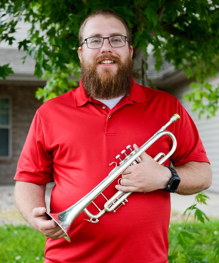Adam Matejek poses with his trumpet
