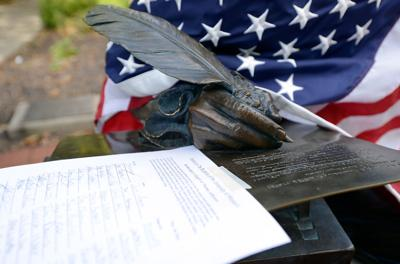 A petition full of signatures is taped on the Thomas Jefferson statue