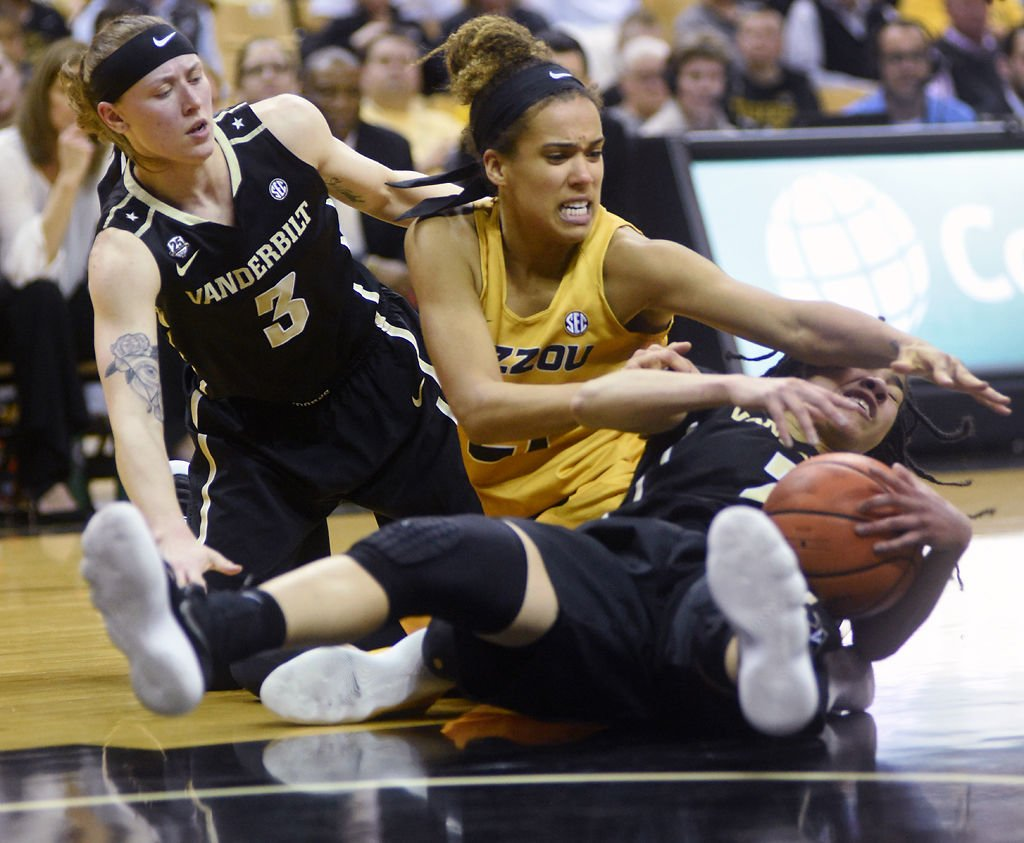 MU women's basketball player Cierra Porter reaches out to grab the ball