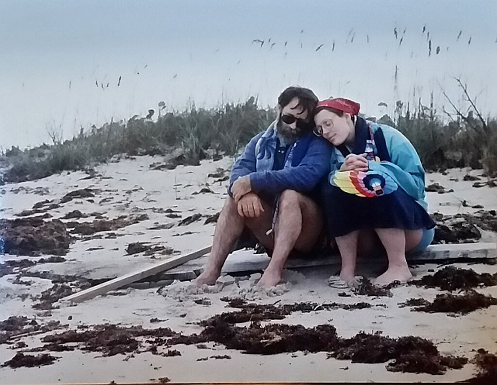 Hank and Marie Taylor sit on the beach