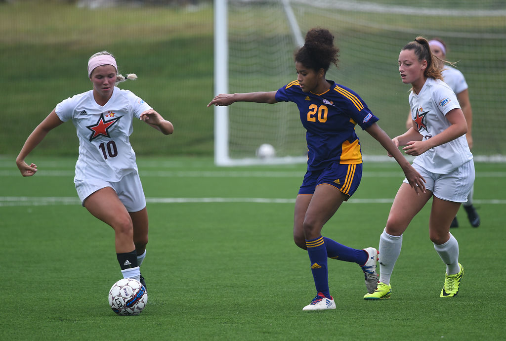 Devin Dowell, Sellena Dixon and Morgan Lange race to the ball