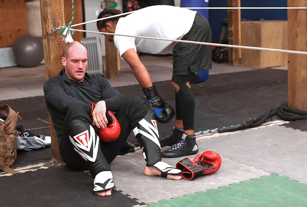 Dallas Jennings, left, rests after sparring with Darian Weeks on Friday, Feb. 19, at the Columbia Training Academy in Columbia.