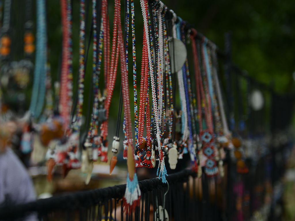 Necklaces hang on display at the Heritage Festival and Craft show