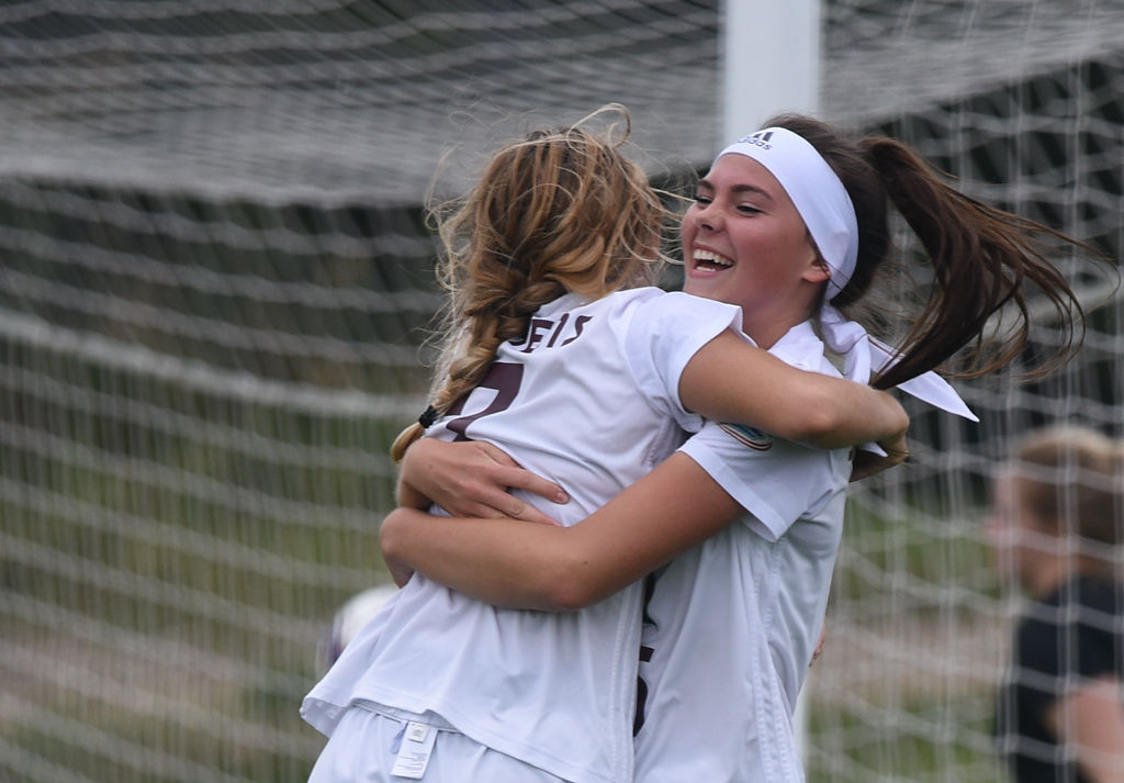 Anya Castelli and Peyton Lane celebrate after Castelli scores Stephens' second goal