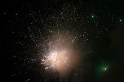A firework explodes in the sky above Lucky's Market during the 2019 Fire in the Sky fireworks show