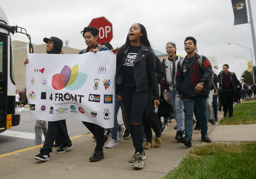 Participants march down Rollins street during the Solidarity Walk