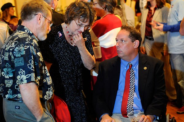 Democratic state Senate candidate Chuck Graham talks with friends on election night in 2008