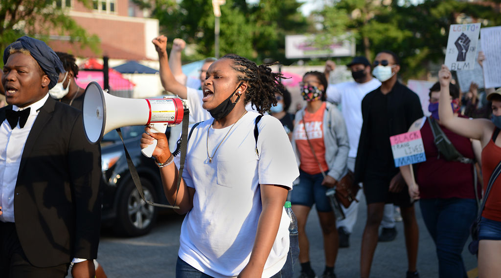 Protesters march from MU's Francis Quadrangle to the Boone County Courthouse amphitheater on Sunday