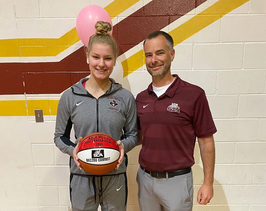 Addison Potts stands with her high school coach