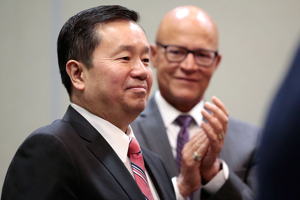 Mike Middleton congratulates Dr. Mun Choi