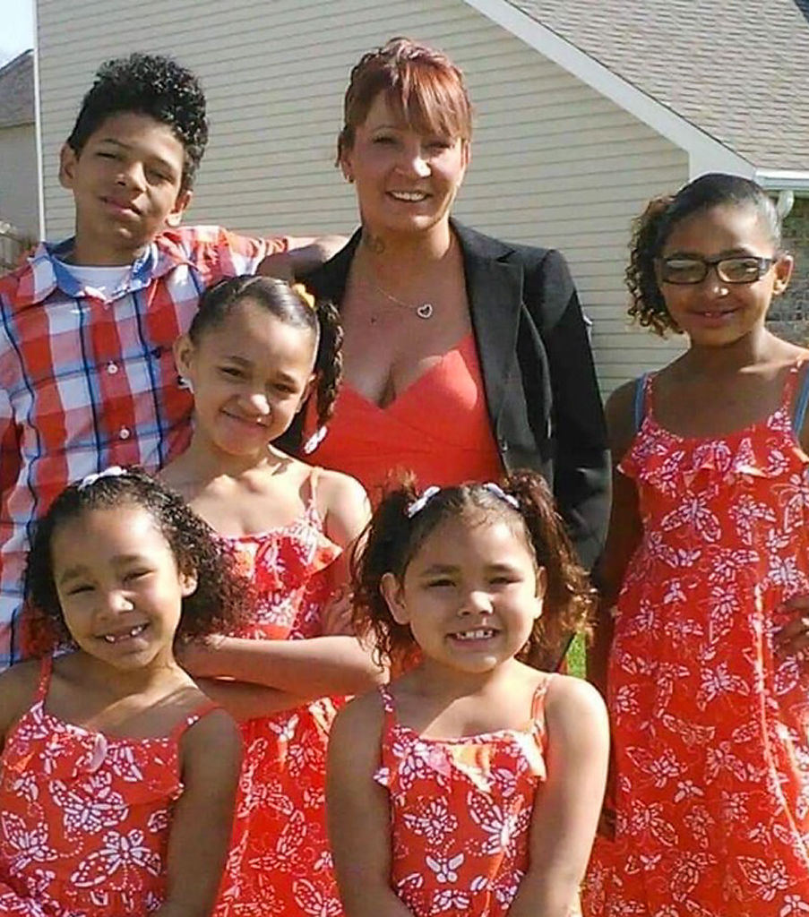 Tara Knedler, center, and her five children