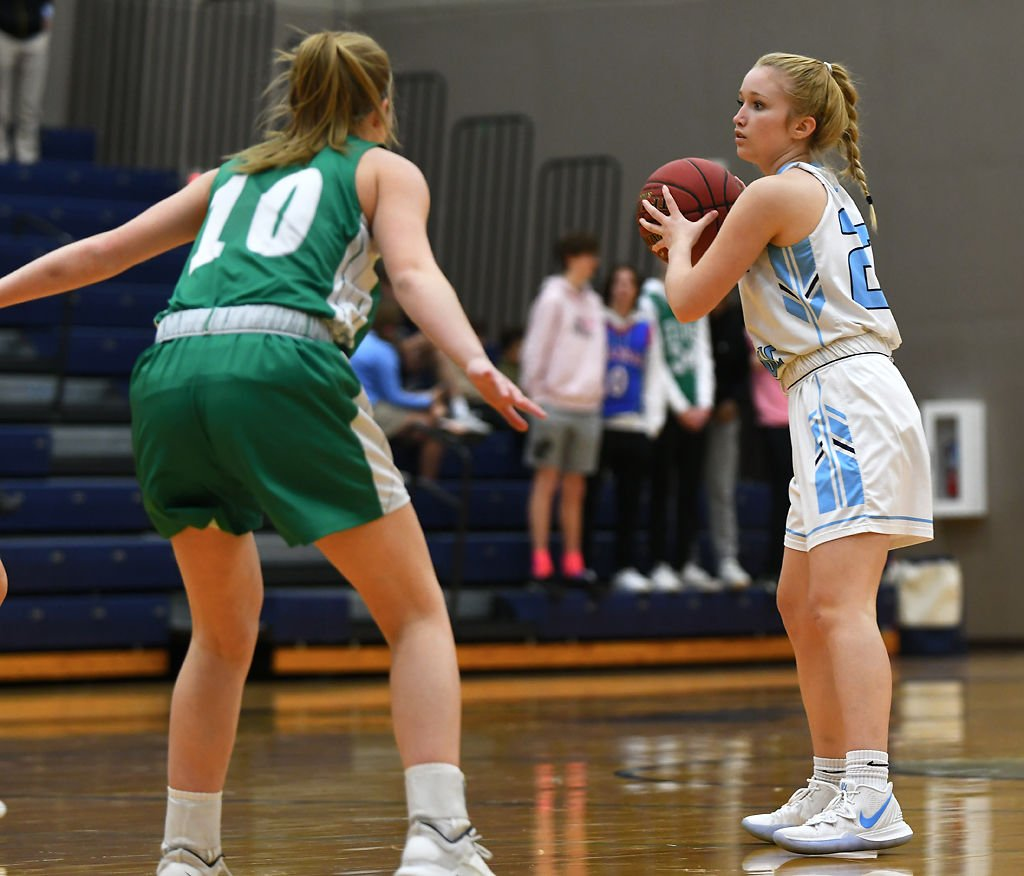 Tolton junior Emma Barnes looks for an open teammate at the girls basketball game
