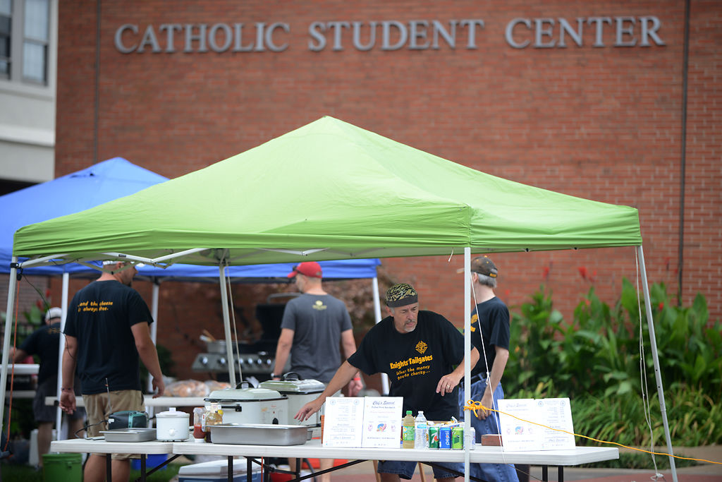 Ed Young sets up the Knights of Columbus table for tailgating at the Newman Center & Itu0027s just what we do:u0027 Tailgaters party through inclement weather ...