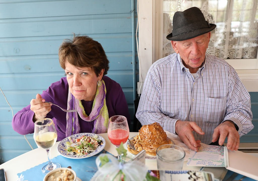 Leslie Goodman, left, and Jack Walts eat lunch before taking cruise tour