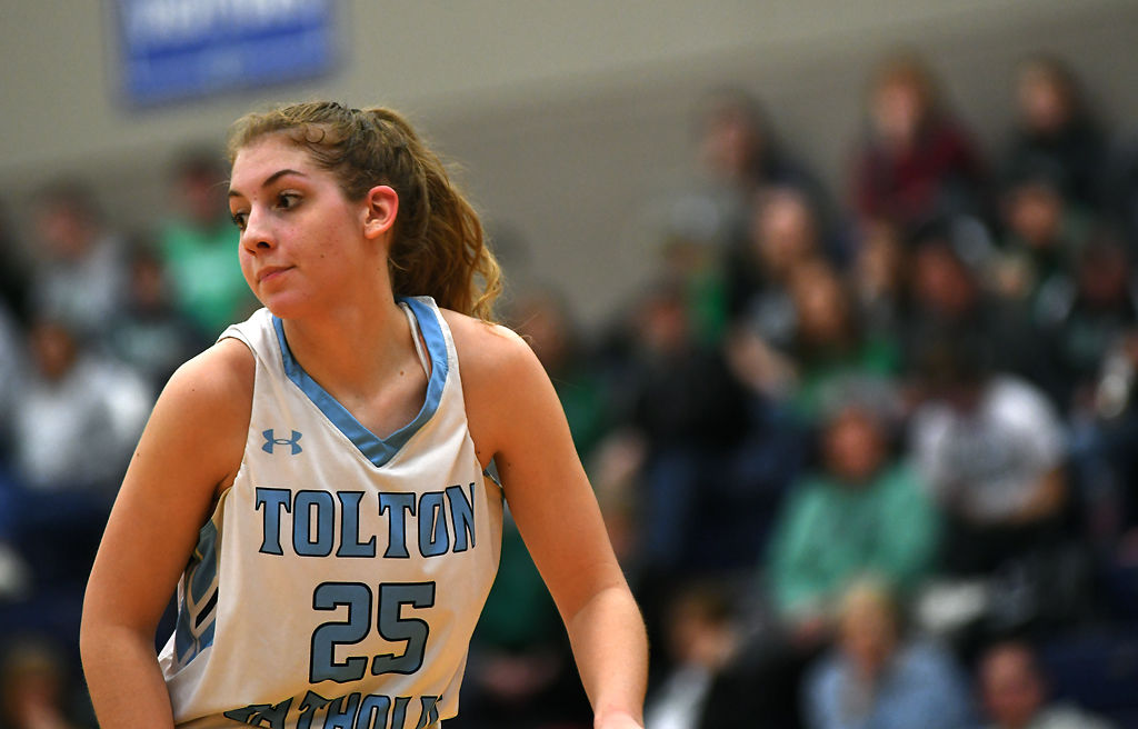 Tolton junior Lizzy Wright runs down the court during the girls basketball game