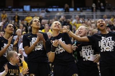 Looking up at the jumbotron, Missouri women's basketball players cheer