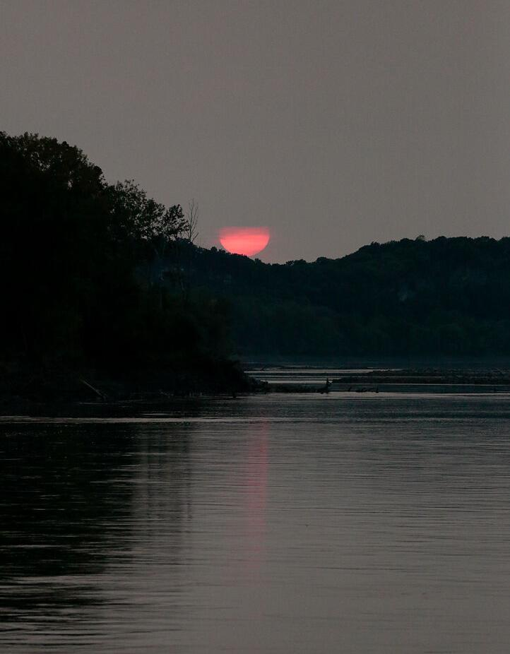 The sun sets on the Missouri River on Tuesday at Cooper's Landing