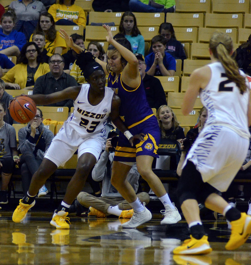 Amber Smith posts up on Western Illinois's Carla Flores