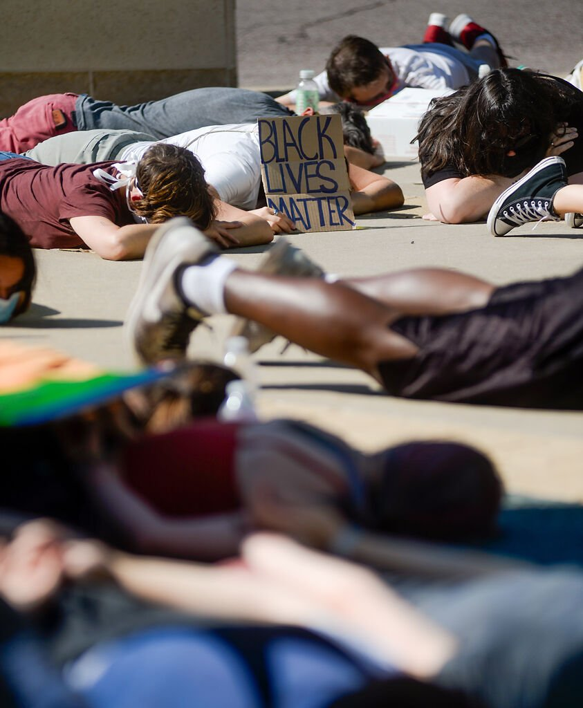 Protesters lay down