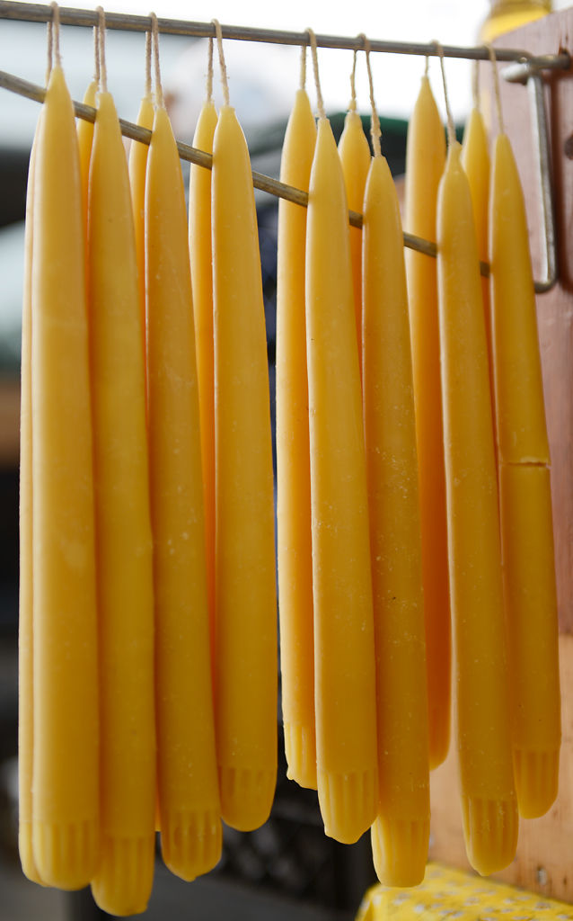 Beeswax candles hang at the Bonne Femme Honey Farm stand