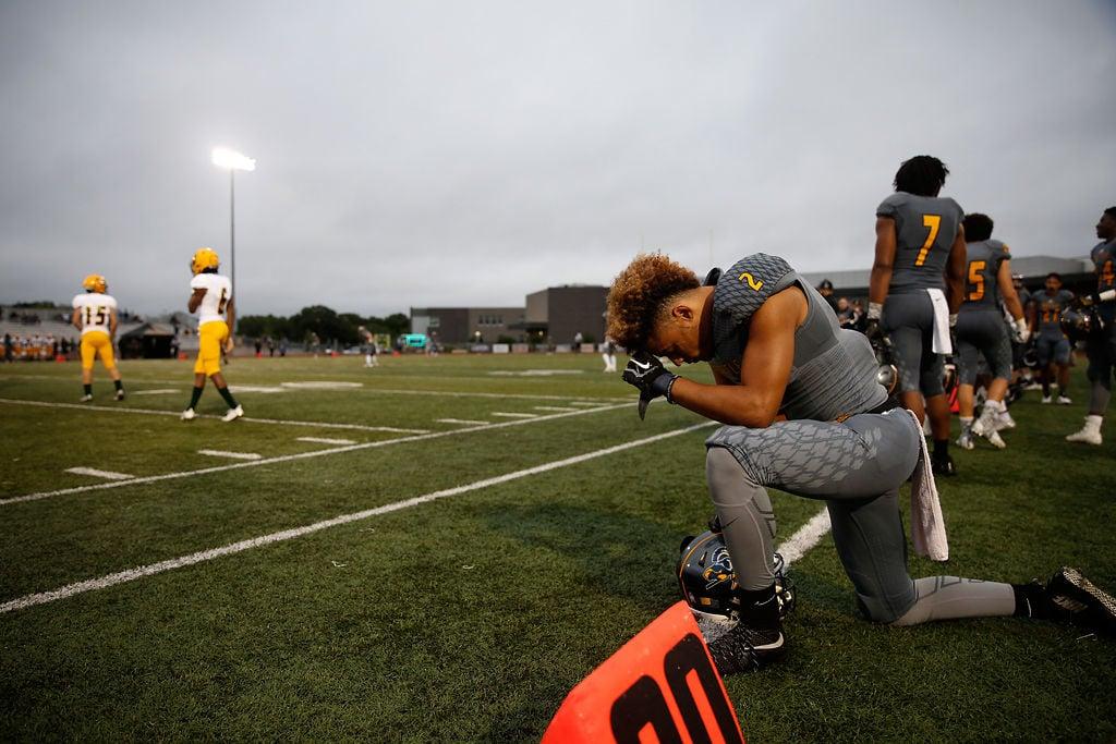Battle High School defensive back Jaylon Williamson kneels in prayer