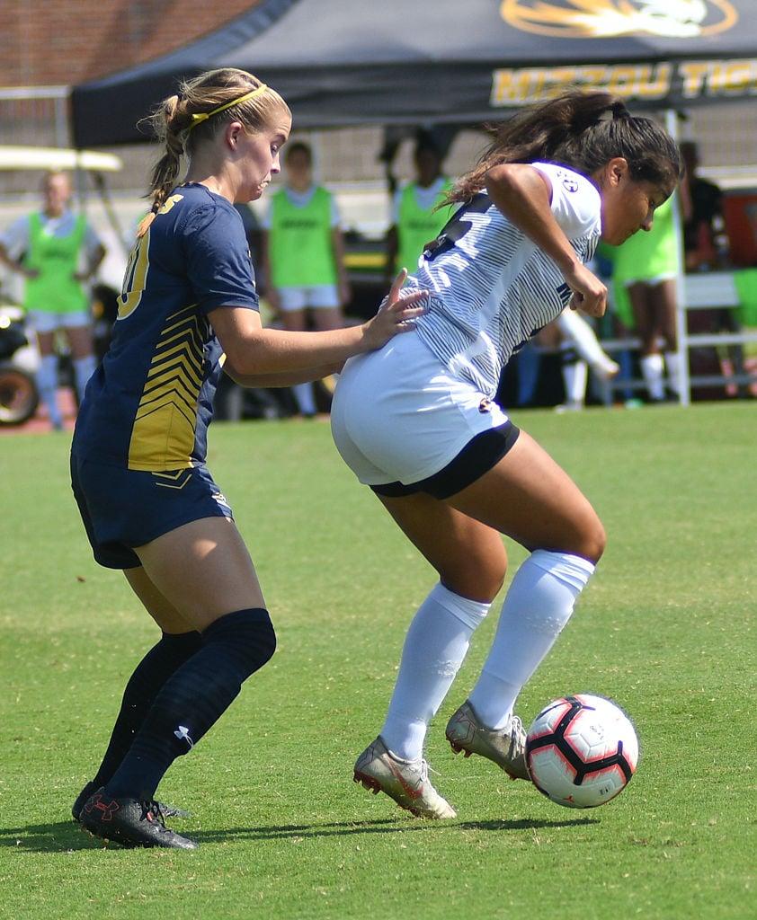 Julissa Cisneros shields the ball